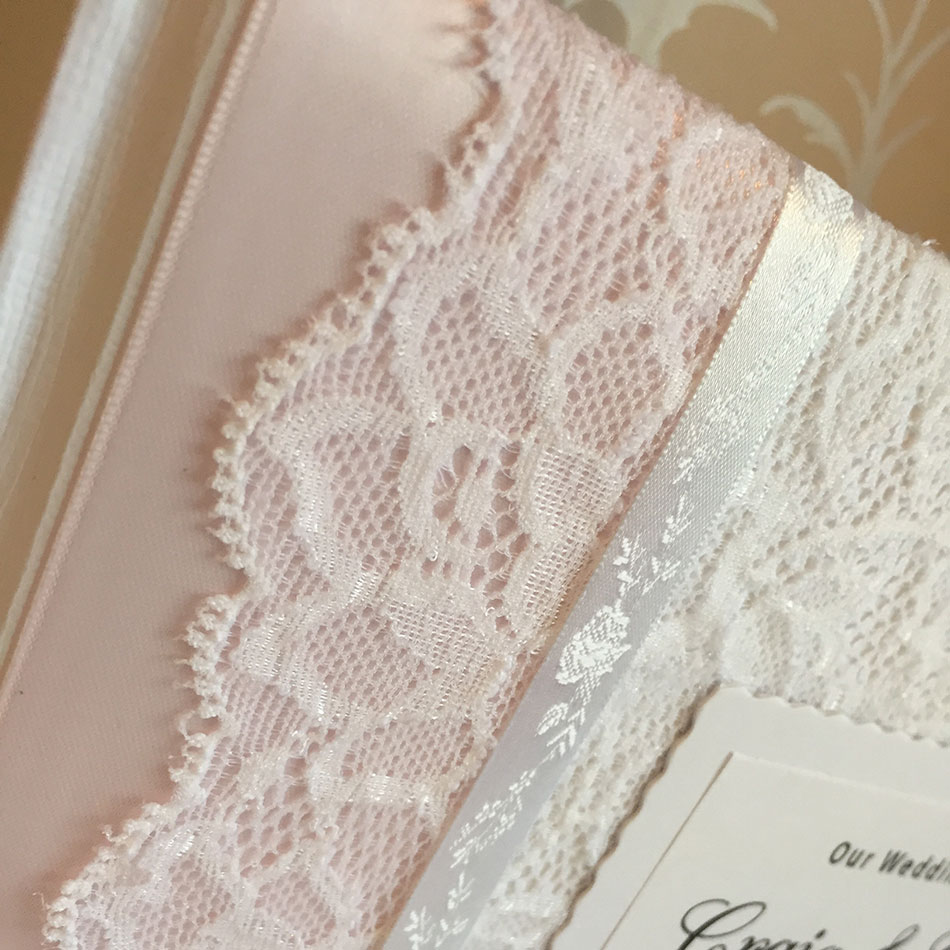 Personalised wedding guest book with light pink ribbon