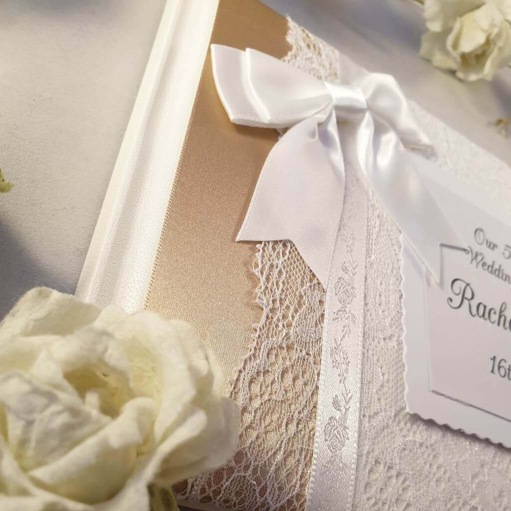 Personalised wedding guest book with gold ribbon