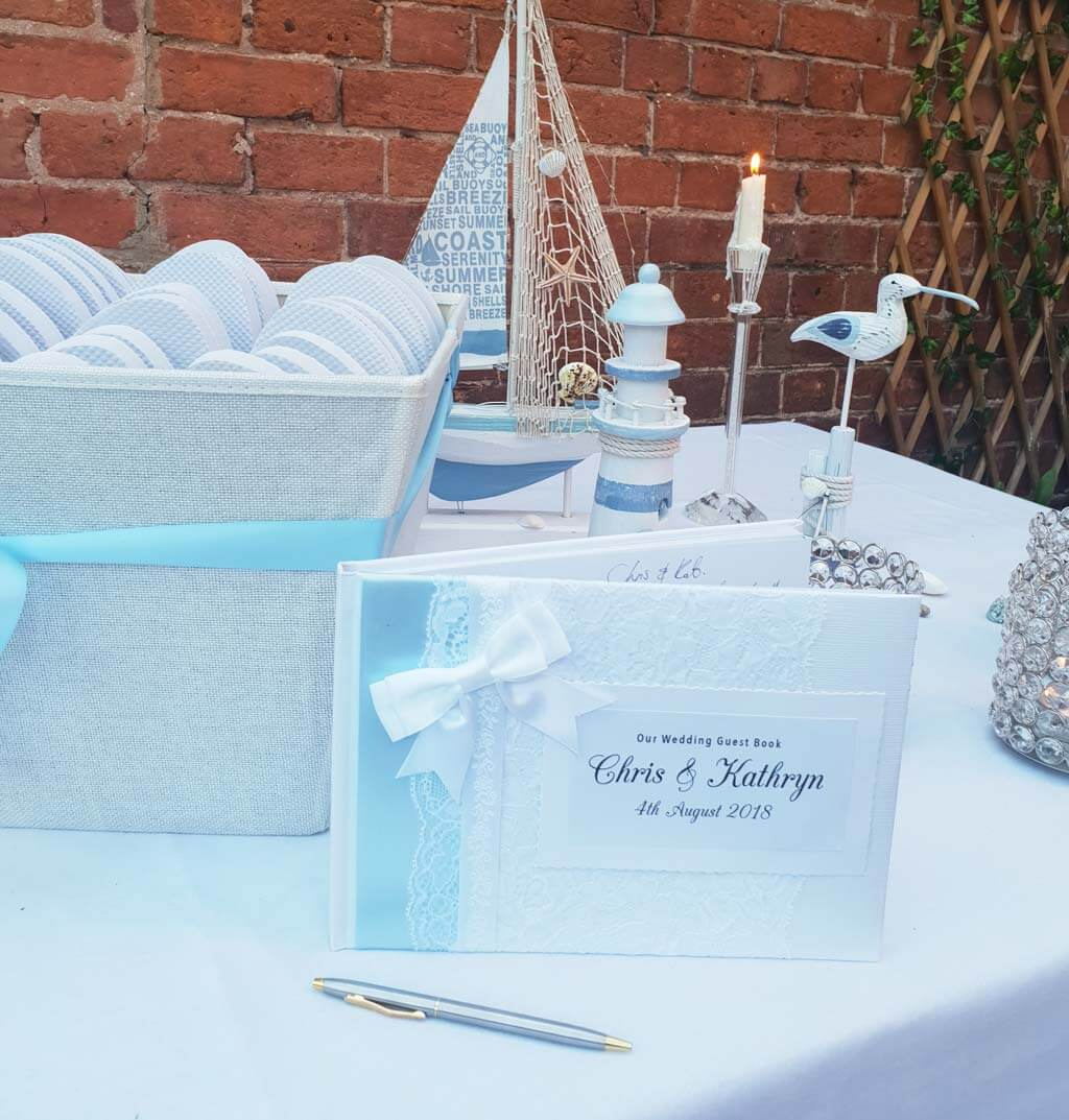 Personalised wedding guest book with baby blue ribbon