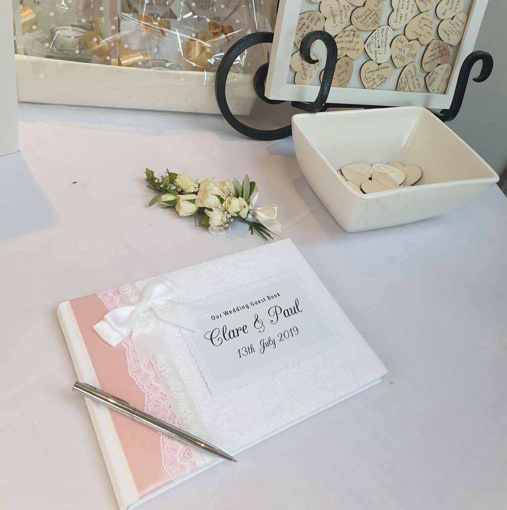 Personalised wedding guest book with baby pink ribbon