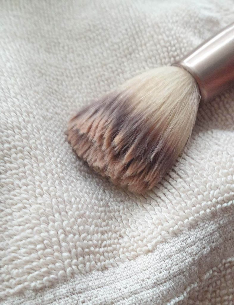 ISOCLEAN Makeup Brush Cleaner - a soaked brush ready for cleaning