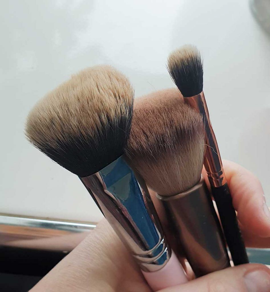 ISOCLEAN Makeup Brush Cleaner - 3 dirty brushes ready for cleaning