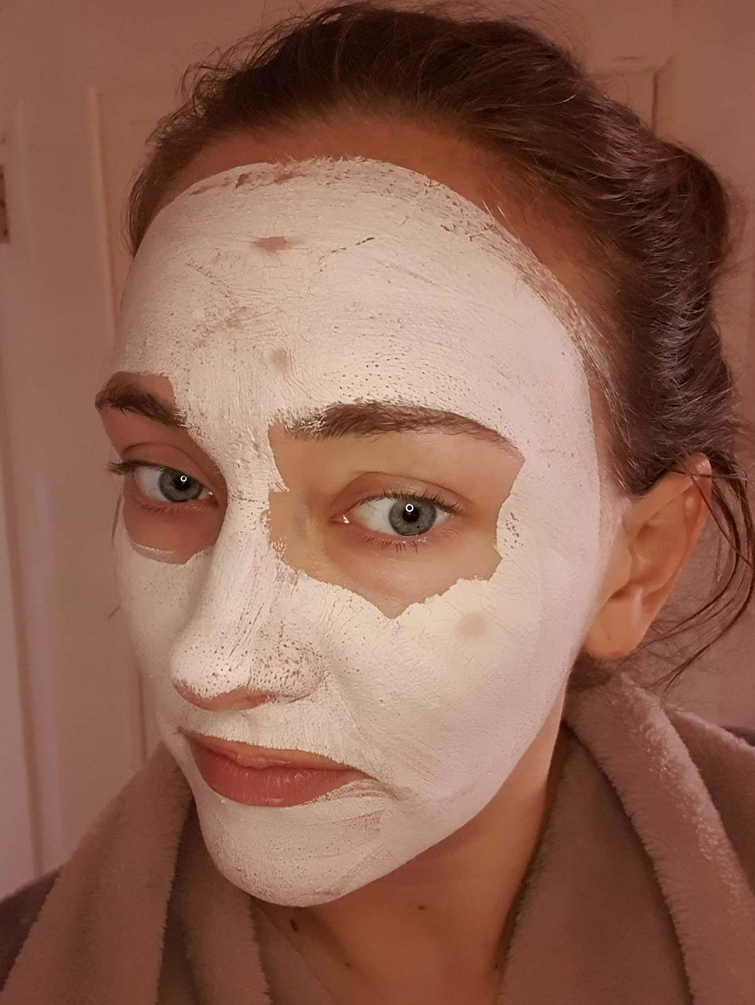 A photo of my face whilst using Sand and Sky Australian Pink Clay Mask