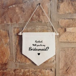 `Personalised hanging wall canvas banner with the text 'Will you be my Bridesmaid' with a space for a name