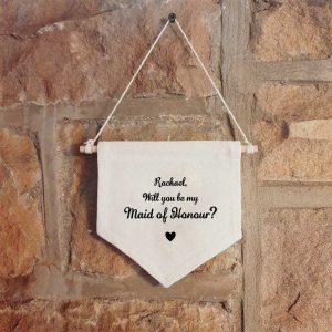 Personalised hanging wall canvas banner with the text 'Will you be my Maid of Honour' with a space for a name
